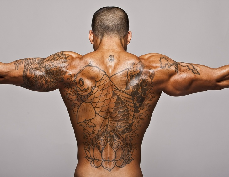 Muscular Man With Nautical Tattoos On Arm