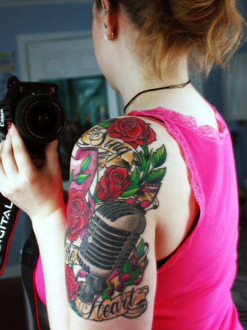 Musical Tattoos On Front Of Shoulder
