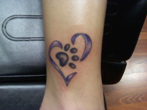 Name And Tiny Paw Print Tattoos On Outer Ankle