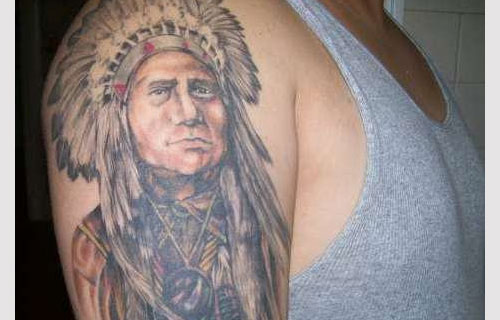 Native American Girl With Feather Headband Tattoo On Arm