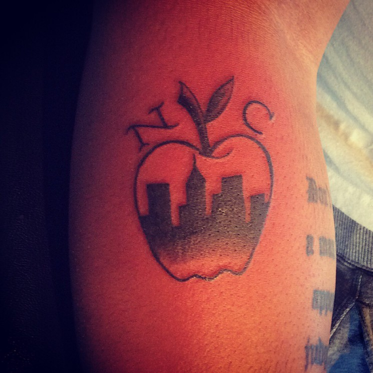 Never Moving Out Apple Tattoo