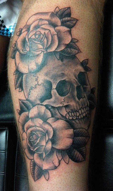 Nice Grey Ink Skull With Roses Tattoo