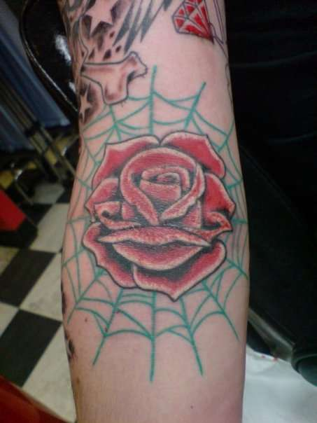 Old School Rose In Spiderweb Inside Of Elbow Tattoo Design
