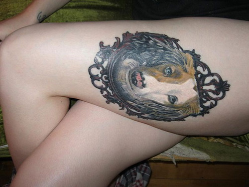 Ornate Frame Thigh Tattoo