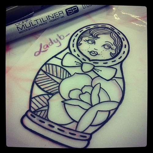Outline Matryoshka Doll Tattoo With Rose
