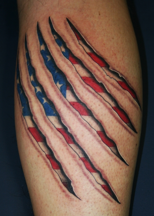 Patriotic Flag Tear Skin Tattoo Behind Shoulder