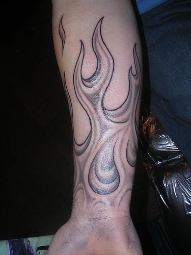 Phoenix And Flames Tattoos On Arm