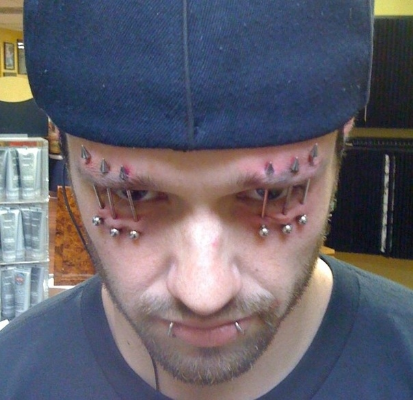 Pierced Nose And Tongue Tattoos