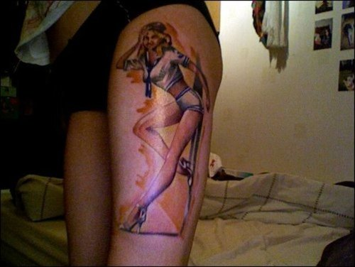 Pin Up Girl Tattoo On Thigh