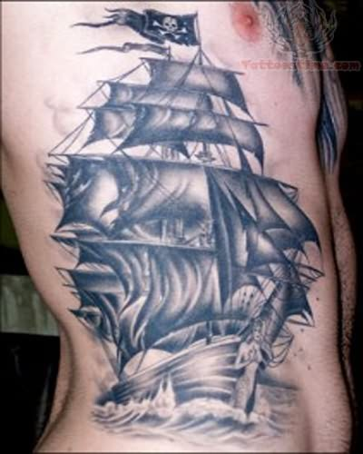 Pirate Ship And Crescent Moon Tattoos On Chest