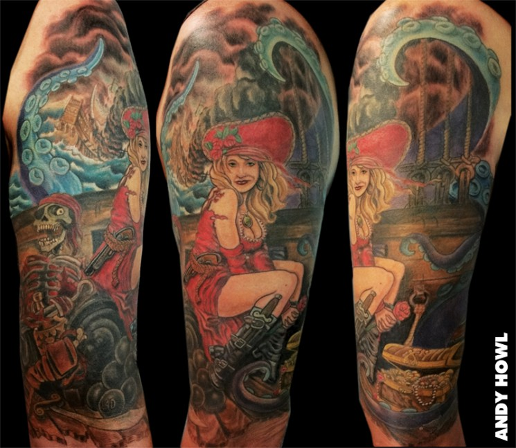 Pirate Ship And Green Waves Tattoos On Left Half Sleeve