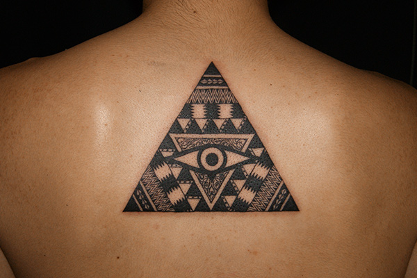 Polynesian Triangle Eye Tattoo On Upperback