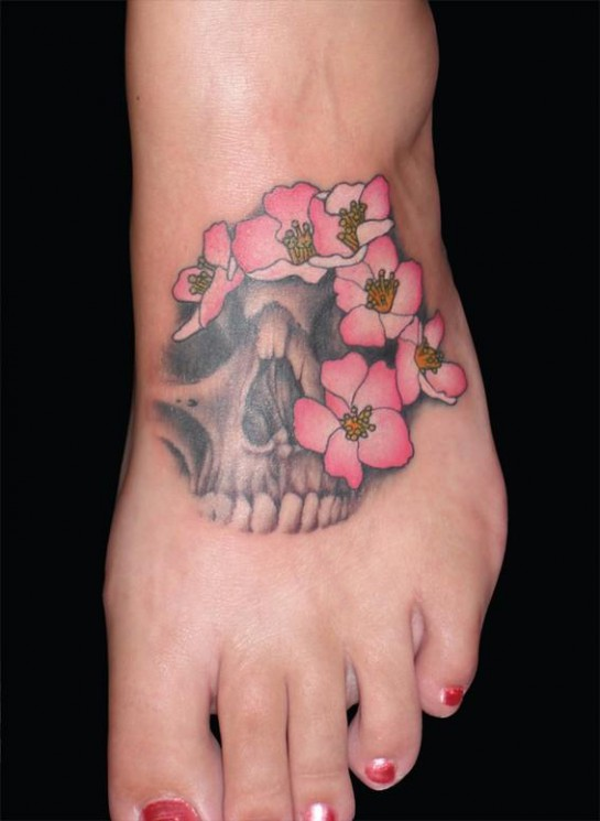 Pretty Blossoms And Skull Tattoos On Foot