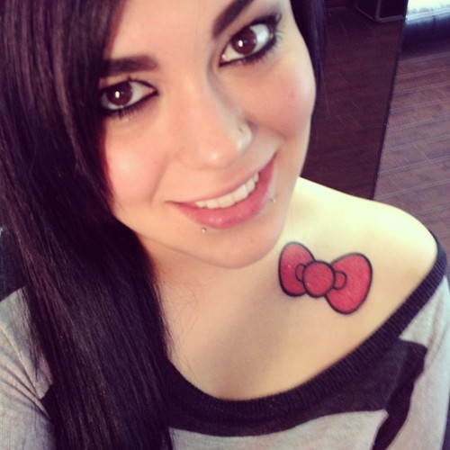 Pretty Red Bow Tattoo On Front Of Shoulder