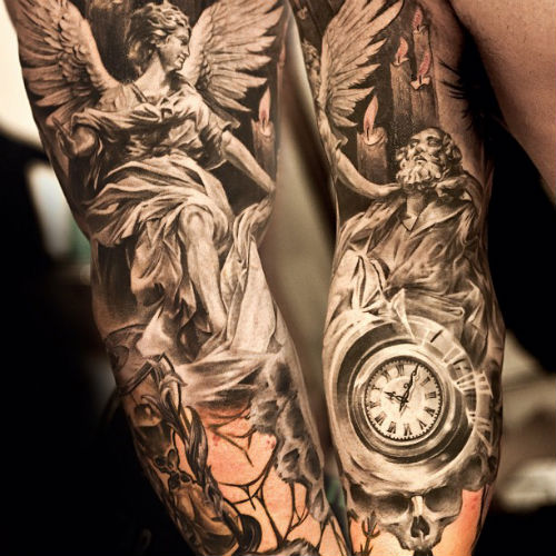 Rays And Soldier Portrait Tattoos On Biceps