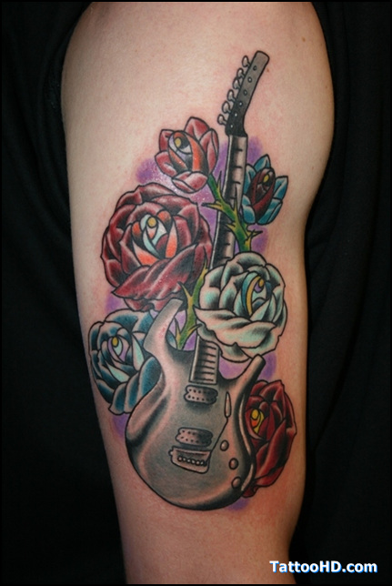 Realistic Guitar And Rose Vine Tattoo On Biceps