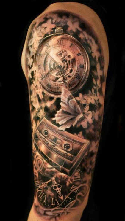 Grey Ink Sandclock With Wings Tattoo On Shoulder