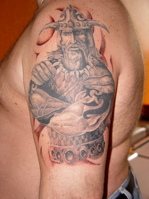 Realistic Viking Face Tattoo On The Shoulder