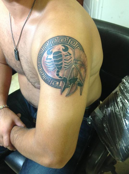 Realistic Warrior Helmet And Shield Tattoos On Shoulder