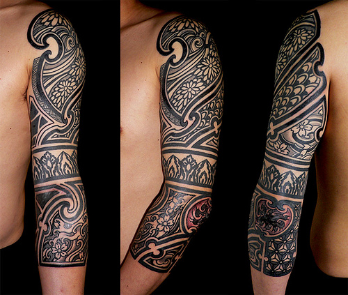 Red And Black Ink Tribal Tattoo