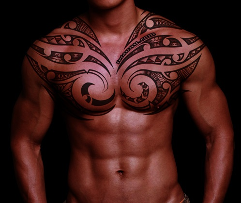 Red Aztec Sun Tattoo On Top Shoulder