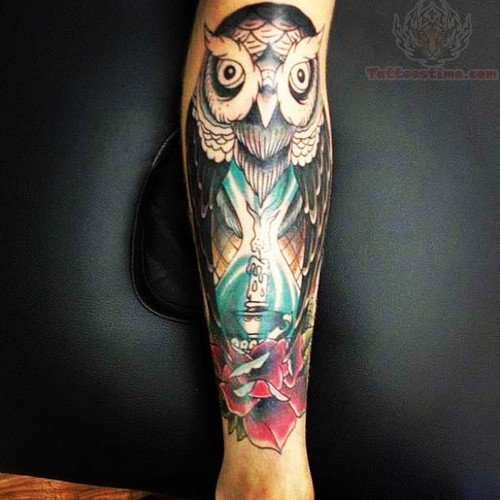 Candle & Hourglass Tattoo On Forearm