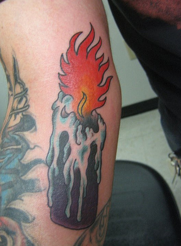 Red Flame Candle Tattoo On Arm