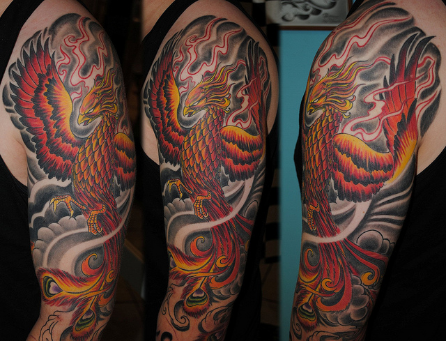 Red Flames And Phoenix Tattoos On Half Sleeve