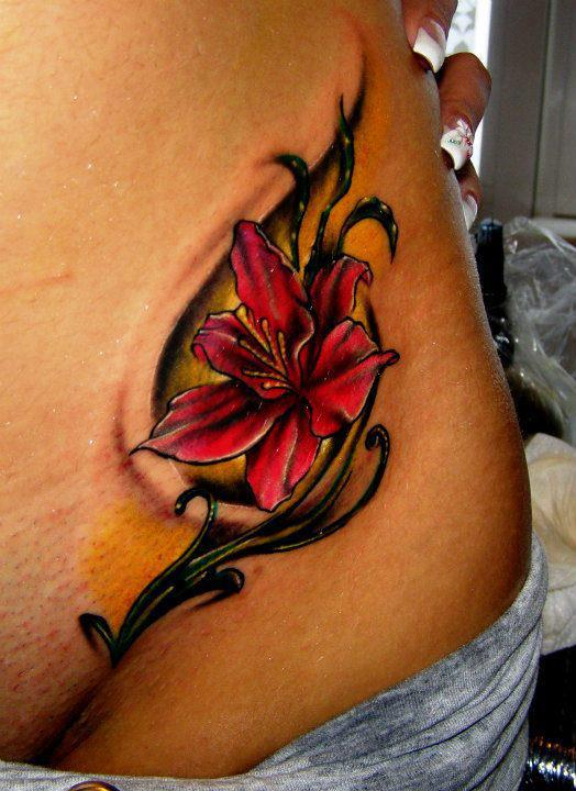 Red Flower And Star Tattoos On Waist