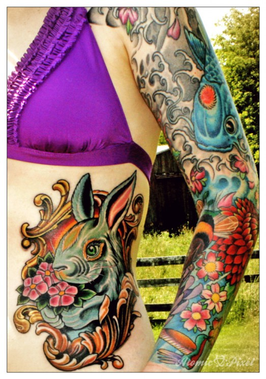 Rabbit And Flower Tattoos On Topless Back