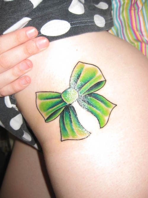 Red Ribbon Bow Tattoo On Back Neck