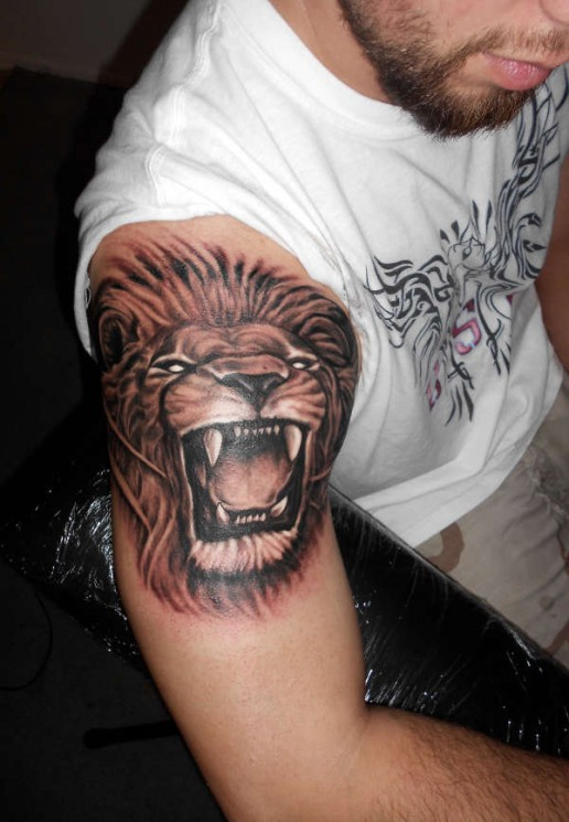 Roaring Lion Tattoo On Muscles