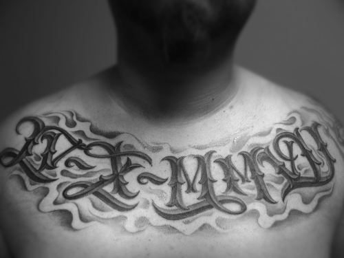Roman Numeral Lettering Tattoo On Chest