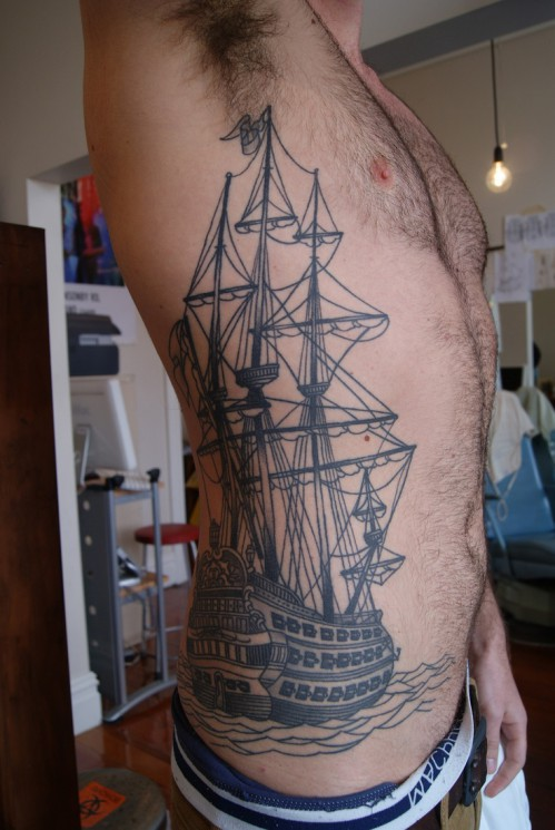 Rose And Tall Ship Tattoos On Frontside Of Body