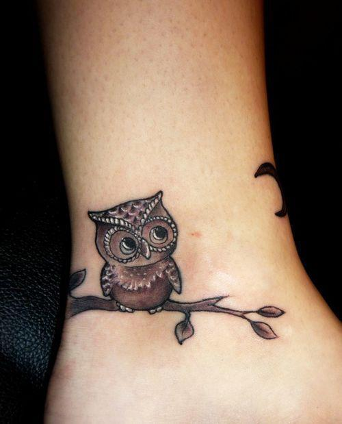 Round Owl On Tree Branch Tattoo