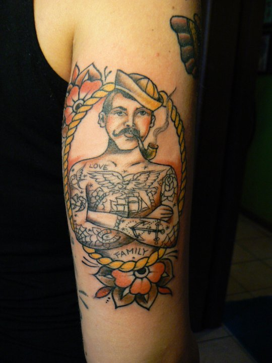 Sailor With Pipe Traditional Tattoo On Back Arm