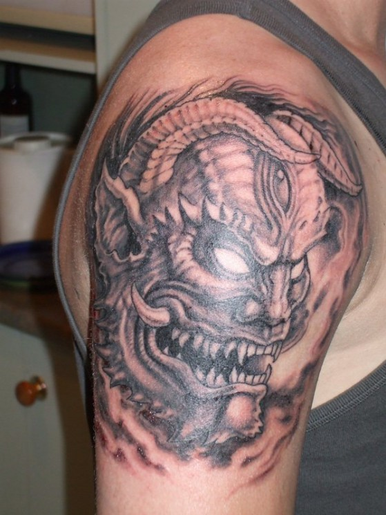 Scary Japanese Mask Tattoo On Chest