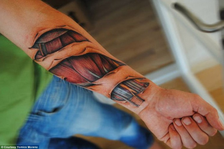 Scary Ripped Skin Bone Tattoo