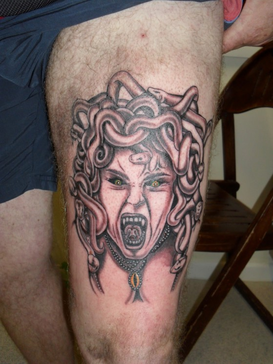Screaming Medusa Tattoo On Thigh
