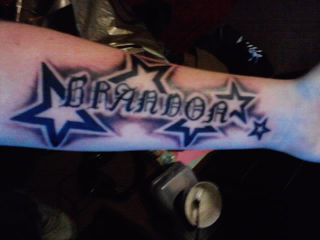 Shaded Outline Stars And Name Tattoos On Forearm