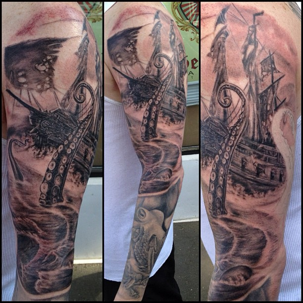 Ship And Green Octopus Tattoos On Sleeve