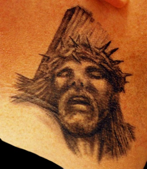 Showing Jesus Head n Cross Tattoo Design