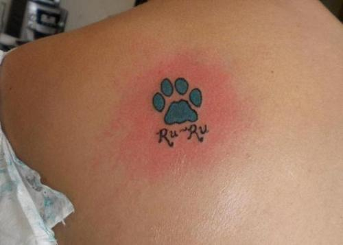 Single Blue Paw Print Tattoo For Women