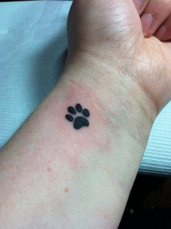 Single Small Paw Print Tattoo On Wrist