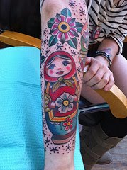 Sleeping Matryoshka And Flowers Tattoo Image