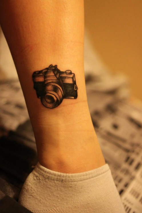 Small Camera Tattoo On Ankle
