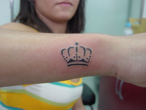 Small Crown Tattoo On Chest Of Girl
