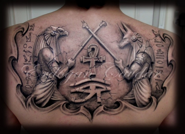 Small Eye Pyramid And Owl Tattoos On Chest