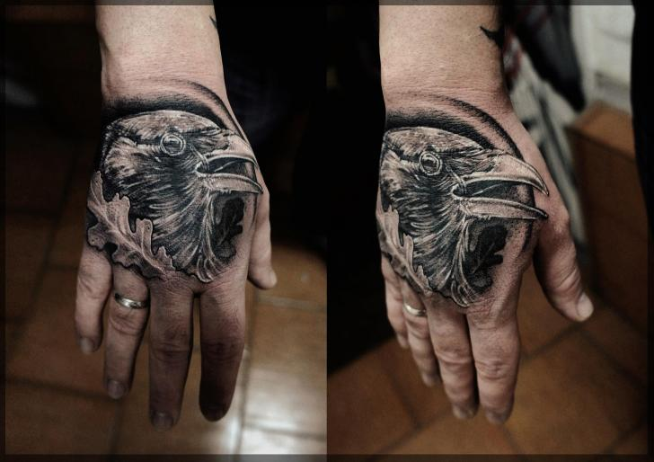 Small Grey Crow Tattoo On Hand