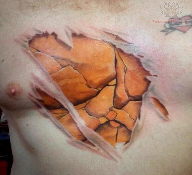 Small Torn Ripped Skin Tattoo On Chest Of Guy